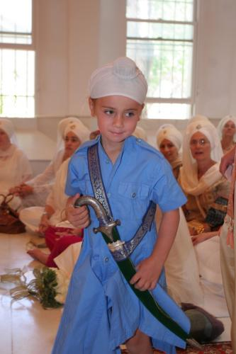 Sikh boy wearing a Kirpan