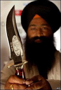 Sikh Male holding a Kirpan