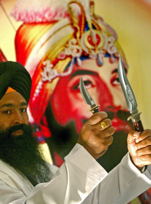 Sikh Male holding two Kirpans