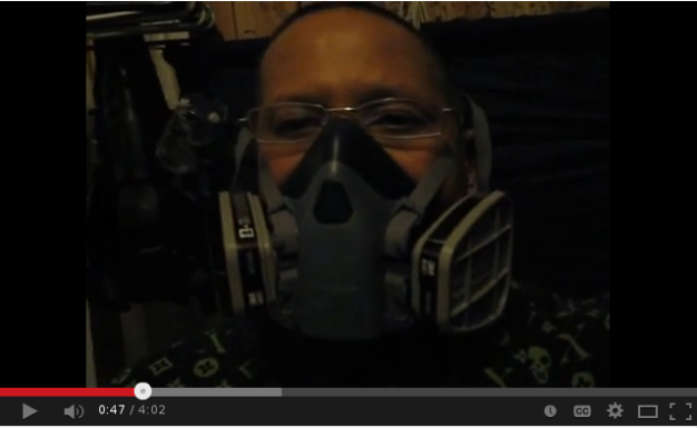 Me wearing a respirator in my room.