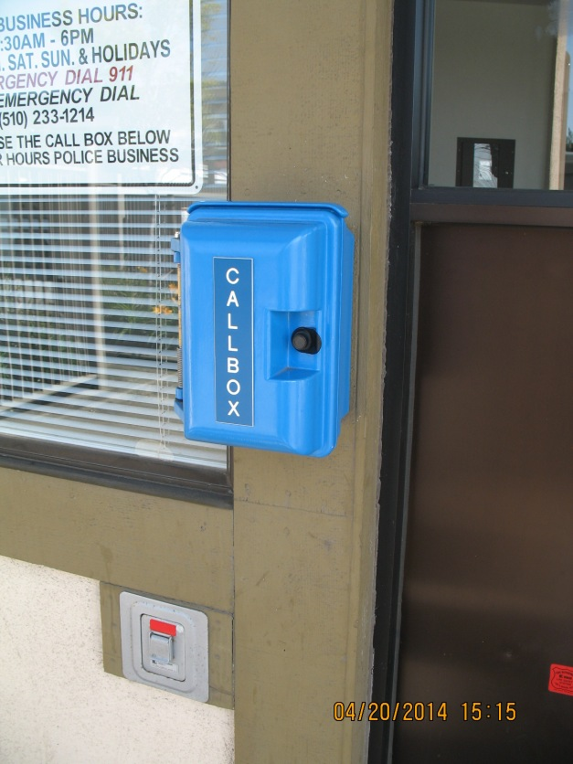 The blue call box that you have to use when the lobby is closed. It connects you to a central dispatcher who tells the officers you are there and for what reason you need assistance.