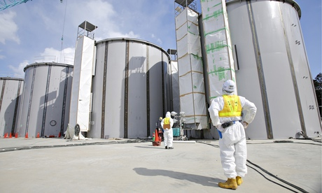 A worker at the Fukushima Daiichi plant looks at tanks, under construction, to store radioactive water. Photograph: Toru Hanai/AP