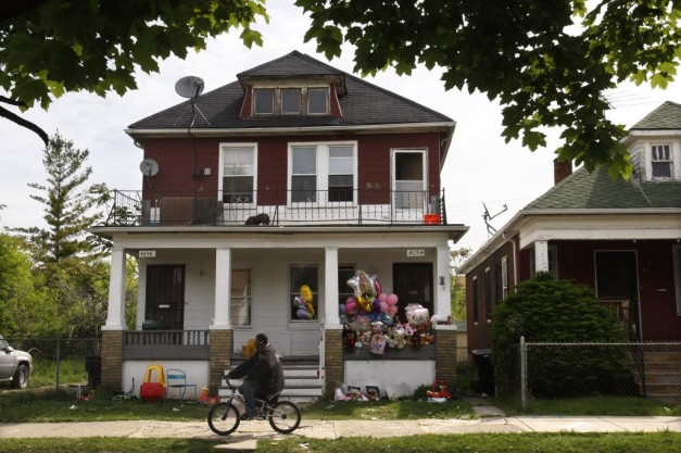The exterior of 4054-4056 Lillibridge Street, where police killed Aiyana Stanley-Jones during a botched raid.  Note the toys in the yard and the prominently-displayed address signs. (AP Photo/Carlos Osorio)