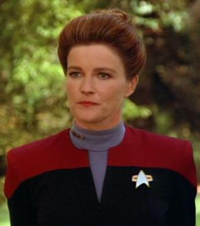 Kate Mulgrew as Captain Katherine Janeway, later to become Vice Admiral